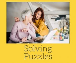 Pic of 2 Women Solving a puzzle